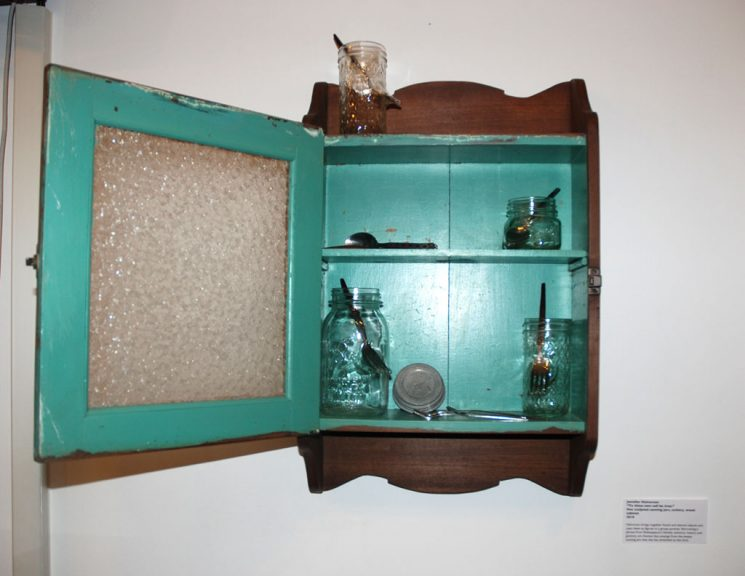 Jennifer Halvorson, To Thine Own Self Be True, 2010. Hot sculpted canning jars, cutlery, wood cabinet
