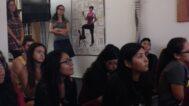 Students listening to Ben Cuevas speak about his work