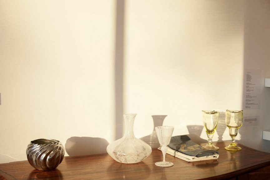 (L to R): Victor DiNovi, Liquor Cabinet, African mahogany; Randy Stromsoe, Ice Bowl, pewter, chased and carved; Aya Oki, Pale Lace Pattern Decanter and Goblet, blown glass; Rya Kihlstedt, Snake and Botanical Bar Towels, hand-silkscreened table linens; Orbix Hot Glass, Jade Handblown Uranium Reservoir Absinthe Glass and Jade Handblown Uranium Chopes Absinthe Glass, blown glass