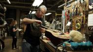 Brian E. Pritchard strings a custom guitar. Mark Markley photograph