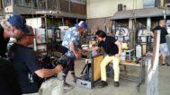 Mitsuda creates a bowl, assisted by T.A. Jonathan Holshue