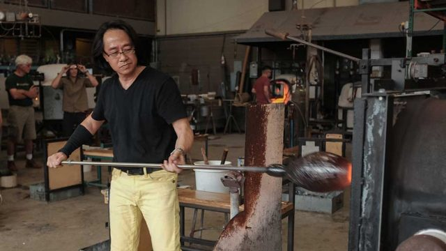 Mitsuda demonstrates how to blow a vase