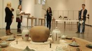 Linda Sikora, Professor of Ceramic Arts at Alfred University, works with her senior students