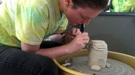 Sarah Boland trimming her altered pot. She loves the perfection of the trimming process