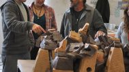 Wayne Higby, Professor of Ceramic Art, works with his students