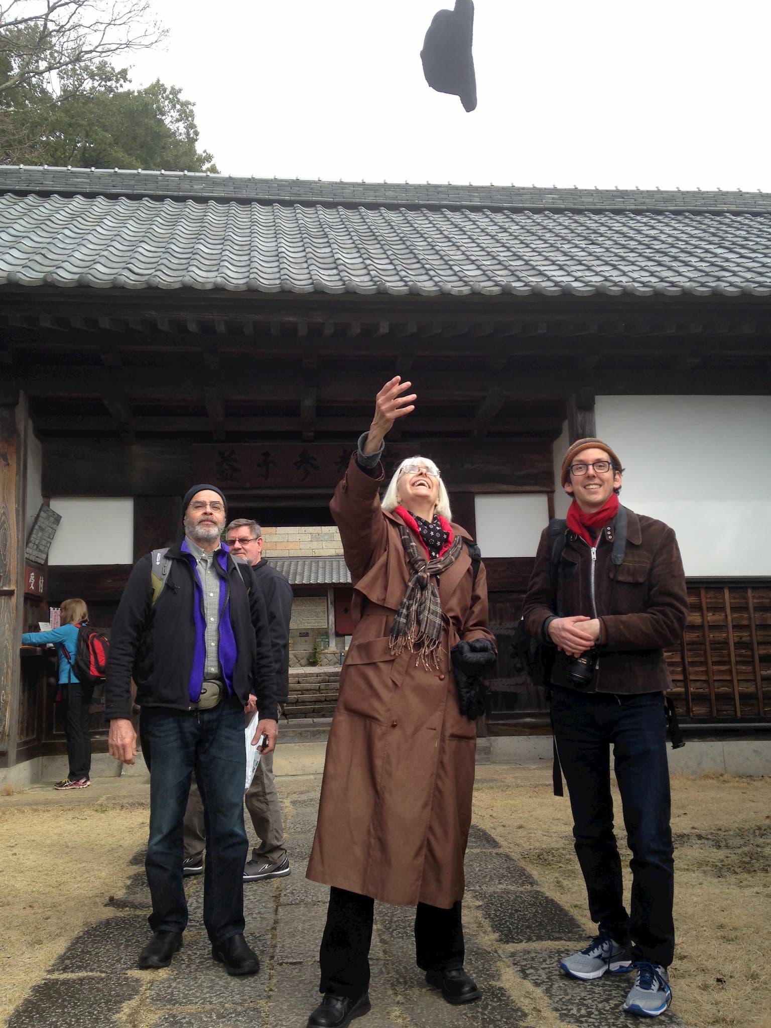 Guillermo Cuellar, Clary Illian, & Mason Hiatt pose in front of Shoji Hamada's studio museum in Mashiko, Japan, 2016. Courtesy of Guillermo Cuellar