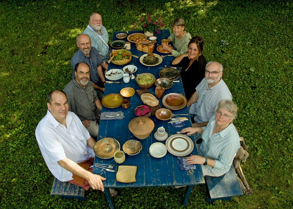 Jeff Oestreich, Guillermo Cuellar, and potters from both Leach Pottery and the St. Croix Valley share a meal together during a tour of the Minnesota pottery, 2012. Courtesy of Guillermo Cuellar