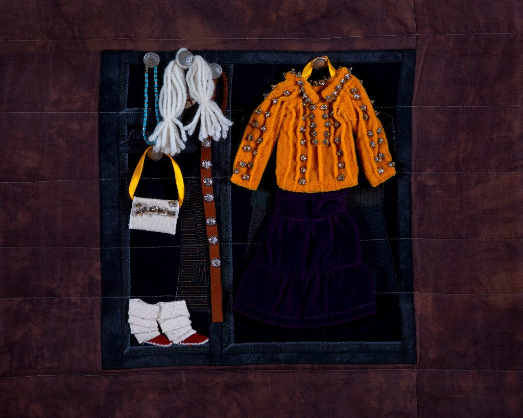 "Susan Hudson, MMIW Since 1492, 2018. Cotton fabric, batting, thread, commercial buttons, leather; 94 x 54 x 1/2"" Image courtesy of the artist. Photograph by Tad Fruits. Craft in America Center Democracy"